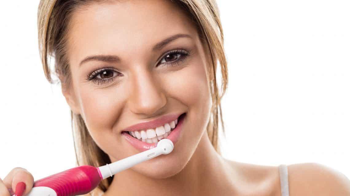 lady brushing her teeth
