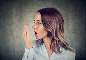 lady experiencing halitosis